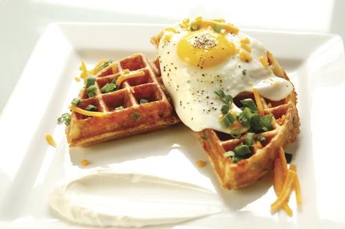 Breakfast waffle with bacon, green onions, cheddar cheese and a fried egg - HEATHER MULL