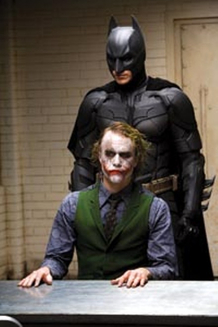 Brothers behind their masks?: Christian Bale, as Batman, and Heath Ledger, as The Joker