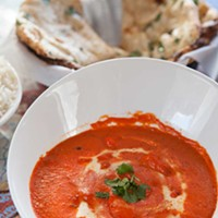 Himalayas Butter chicken with garlic naan Photo by Heather Mull