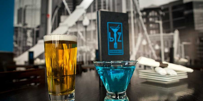 BZ BZ offers draft beers and cocktails, such as the blue chocolate martini (pictured) Photo by Heather Mull
