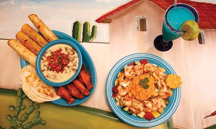 Camarones Patron: butterflied shrimp with vegetables, rice, and cheese sauce; and an appetizer sampler with fiesta dip - HEATHER MULL