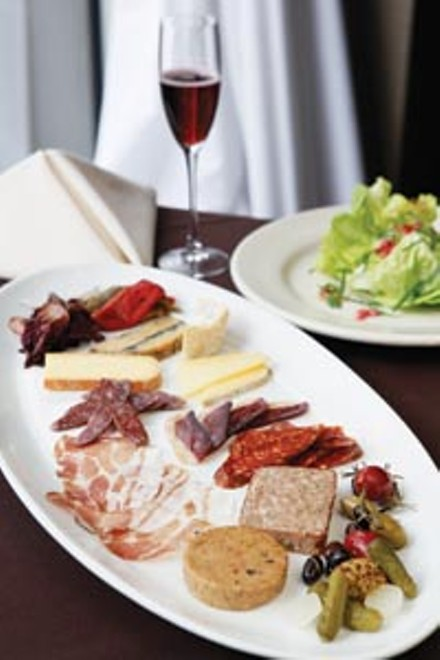 Charcuterie platter featuring house-prepared meats, pates, local and international cheeses, with Bibb lettuce salad - HEATHER MULL