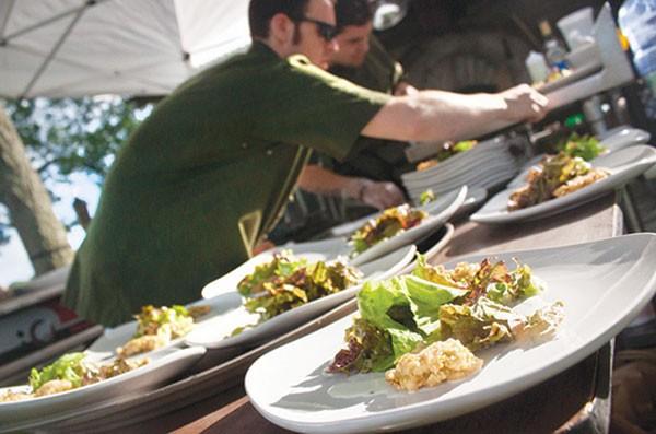 Chef Jacob Mains, of The Farmer's Table, plates food.