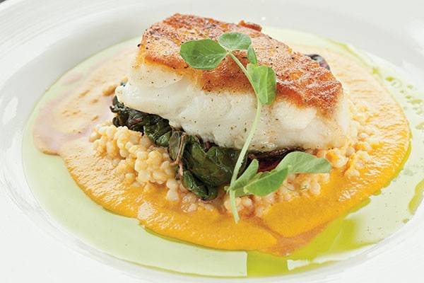 Chilean sea bass with saffron-lobster couscous, Swiss chard and carrot-ginger emulsion - PHOTO BY HEATHER MULL