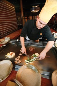 Chop, chop: Marty Mihelic works the grill at Nakama. - HEATHER MULL