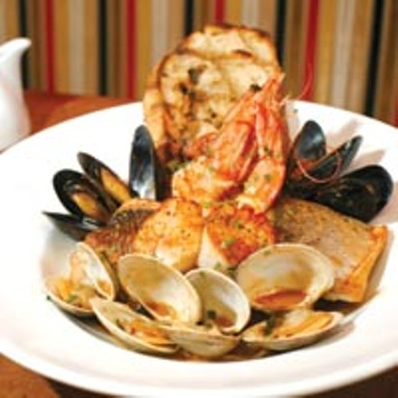 Cioppino with branzino, snapper, clams, mussels, Dungeness crab, scallops, whole prawns, onion, fennel and garlic crostini. - HEATHER MULL