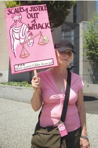 "Code Pink member Diane Santoriello was one of a dozen protesters upset with President Bush's handling of Lewis ""Scooter"" Libby's prison sentence. - PHOTO BY BRIAN KALDORF"