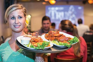 Comin' in hot: Bigham waitress Nikki Rockey, with a fresh plate of wings
