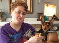Cori Frazer with her emotional-support dog, Aiden
