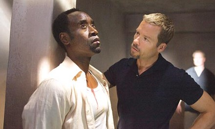 Countrymen at odds: Don Cheadle and Guy Pearce