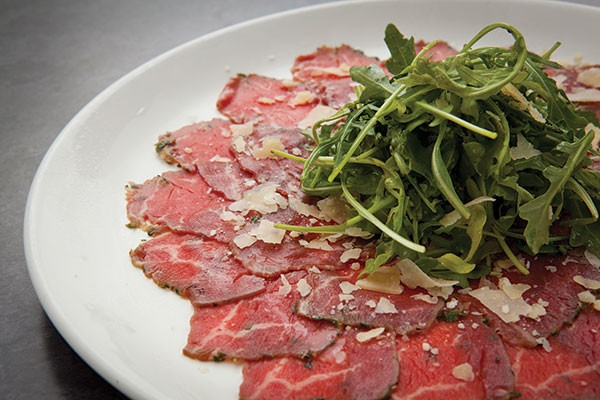 Cracked-pepper-crusted beef carpaccio and greens at Blue Line Grille