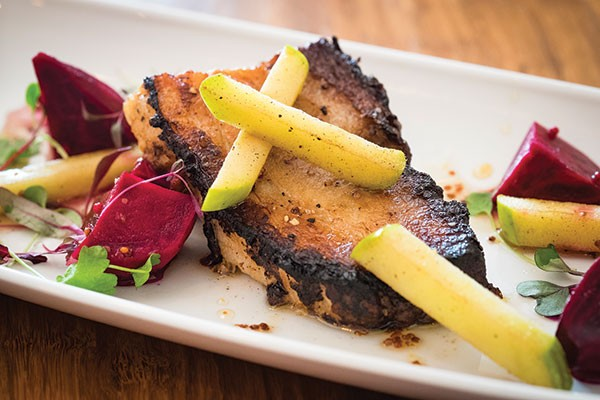 Crispy pork belly with caramelized apples, pickled beets, whole-grain mustard and apple-cider gastrique