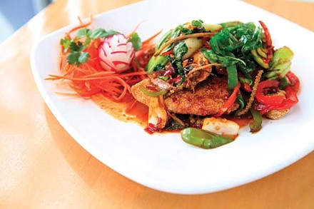 Crispy tilapia, sauted in a spicy garlic sauce, with baby peppers and wild ginger - PHOTO BY HEATHER MULL