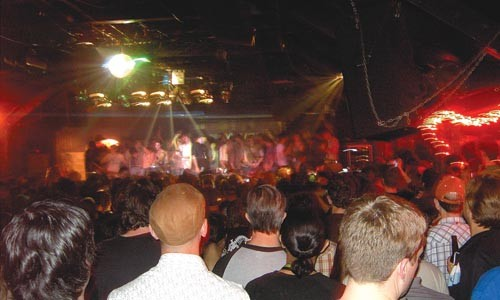Critical mass: Girl Talk fans storm the stage at the Elysium