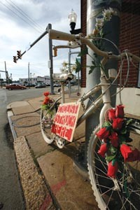 Cycling advocates place a ghost bike at places where riders have been struck by cars. - PHOTO BY HEATHER MULL