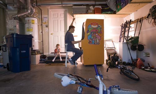 Daddy Kong: Steve Wiebe plays hard while his son looks on.