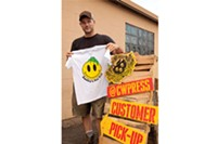 Dan Rugh, of Commonwealth Press, with Smiley's T-shirts