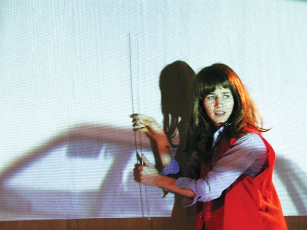 David Nakamoto's photo of a Miranda July performance called The Swan Tool, part of Alien She