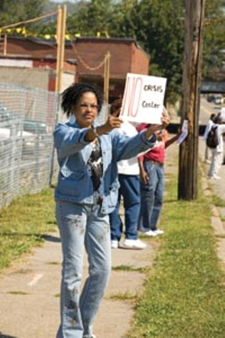 Debra Stubbs voices her opinion over the construction of a new crisis center. - BRIAN KALDORF