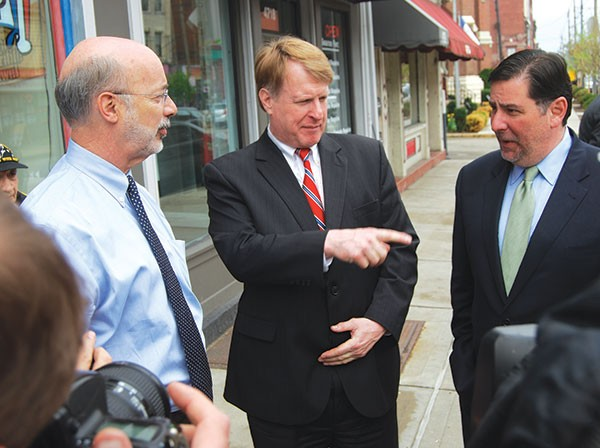 Democratic gubernatorial candidate Tom Wolf tours Bloomfield with Allegheny County Chief Executive Rich Fitzgerald and Pittsburgh Mayor Bill Peduto last month.