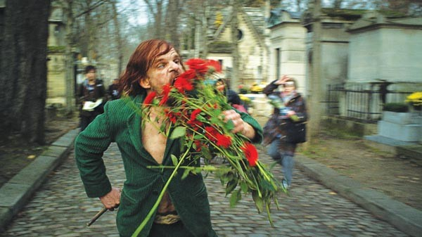 "Denis Lavant, as ""Oscar,"" portraying the Wild Man of Pere Lachaise"