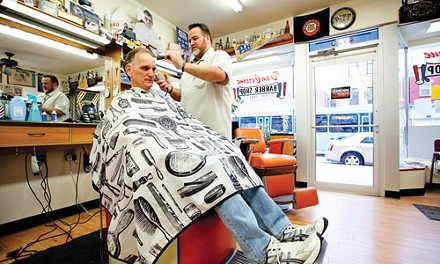 Dennis Scullion trims the hair of customer Jack Linn in the barbershop Scullion's grandfather started in 1931. - JOHN ALTDORFER
