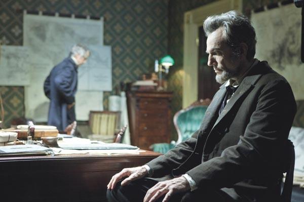 Desk job: President Abraham Lincoln (Daniel Day-Lewis, at right)