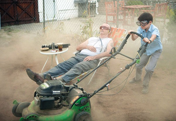 Division of labor: Bill Murray and Jaeden Lieberher tackle some yard work