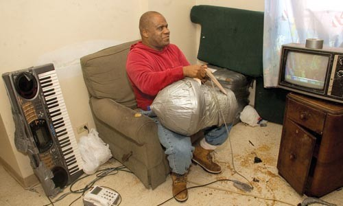 Dorsey, in his Hill District apartment, checks the cord on his customized blender.