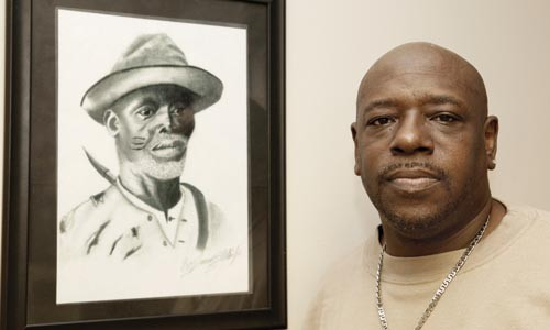 "Drawn in: James E. ""P-Wee"" White and his drawing ""The Eagle Hunter"" at the Hill District barbershop where he works."