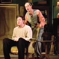 Drinking it in: Christopher Donahue (seated) and Mark Ulrich in <i>The Seafarer</i>, at City Theatre.