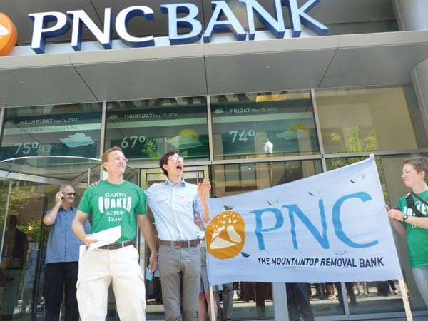 Earth Quaker Action Team protests PNC May 16. - PHOTO BY LAUREN DALEY