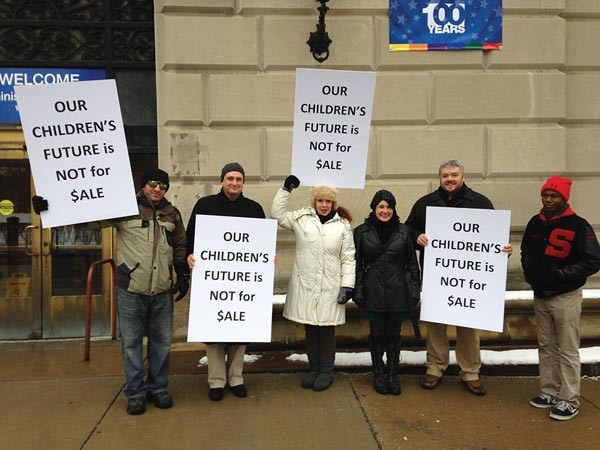 Edward Alexei (second from left), Liz Berlin (fourth from left) and David Tinker (fifth from left) protest with other Schenley alumni last week. - PHOTO COURTESY OF PITTSBURGH URBAN MEDIA