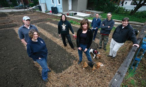 Enright Garden volunteers (from left): Tait Tomb; Kim Wynnyckyj, of Whole Foods; Dan Allen; Sallyann Kluz, with beagles Pearl and Fred; Mikal Merlina; Matt Miller; and Casey Dill, of Whole Foods - HEATHER MULL
