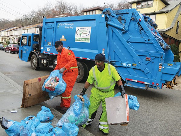 Erin Gilbert and Britt Brooks with the city's Department of Public Works collect recyclables.