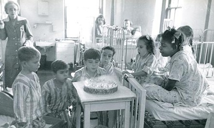 """Esther Bubley's """"Birthday Children Blowing Out the Candles"""" (1951) - COURTESY OF CHILDREN'S HOSPITAL OF PITTSBURGH OF UPMC"""