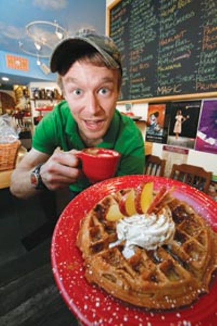 """Ethan Clay, proprietor of Oh Yeah!, gets behind the """"Baked Apple"""" waffle sundae. - HEATHER MULL"""