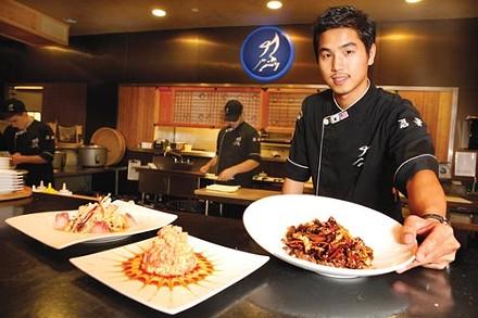 Executive chef Imsub Lee with (from left) tai mika salad, volcano blossom and bulgogi teriyaki - PHOTO BY HEATHER MULL