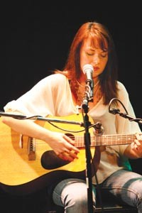 Familiar faces and signature songs predominate at AcoustiCafe, but there's always room and a supportive audience for someone new. Crystal Morgan has performed at Club Caf as a vocalist; here, though, she plays guitar in public for the first time. - HEATHER MULL