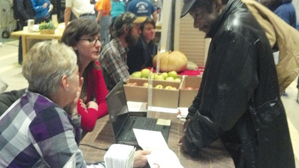 Farmers at a CSA fair Saturday