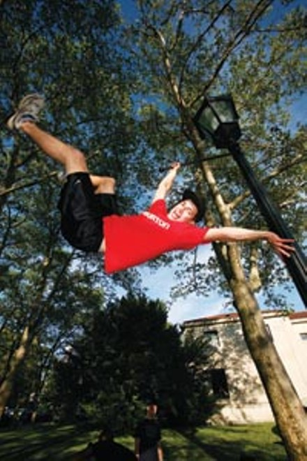 Flag day: Alex Rodia does Gene Kelly one better on a lamppost. - HEATHER MULL