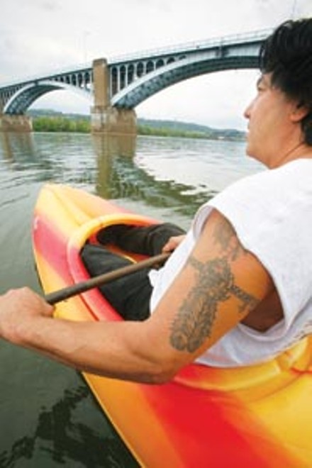Float on: Jesse Santiago of Millvale's Bait and Tackle Shop - PHOTO: HEATHER MULL