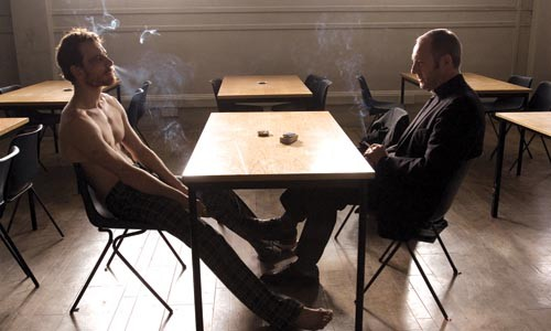 Food, not bombs: Bobby Sands (Michael Fassbender) and Father Moran (Liam Cunningham) discuss a hunger strike.
