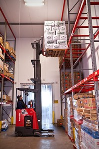 Forklift  full of cabbages at food bank