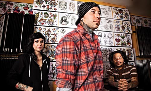 """From left to right, tattoo artists Jesse Buman, Justin Palencsar and Brian """"Bullets"""" Holton - BRIAN KALDORF"""