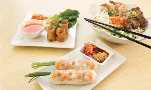From top left: grilled meat with vermicelli noodles, crispy rolls and fresh spring rolls - HEATHER MULL