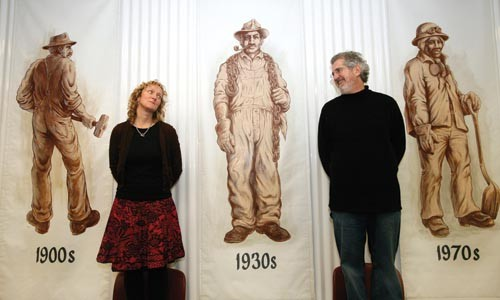 """Gallerist Tavia La Follette and her husband (and co-curator) Gary Huck in their exhibit """"The Gritty 250"""" at 820 Liberty Avenue - HEATHER MULL"""