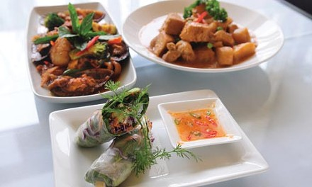 Garden roll, massaman curry with chicken (left) and spicy seafood