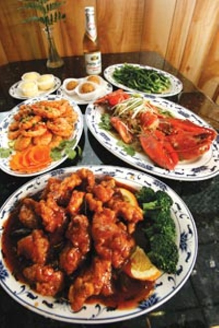 General Tsao's chicken (front), salt-and-pepper shrimp (left) and lobster with ginger-scallion sauce (right) - HEATHER MULL