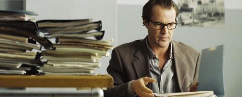Georg Dreyman (Sebastian Koch), among the texts